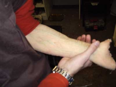 Fake arm for hair removal gag